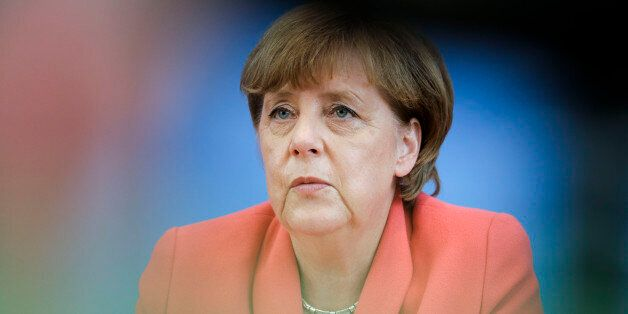 German Chancellor Angela Merkel attends her annual summer news conference in Berlin, Monday, Aug. 31,...