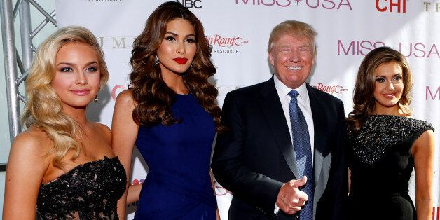 (left to right) Miss Teen USA 2013 Cassidy Wolf, Miss Universe 2013 Gabriela Isler, Donald Trump, and...