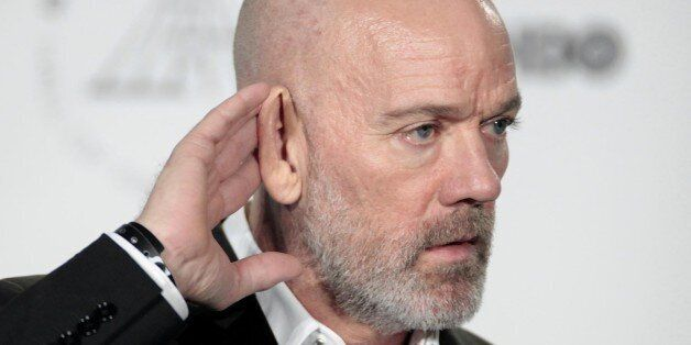 Michael Stipe appears in the press room at the 2014 Rock and Roll Hall of Fame Induction Ceremony on...