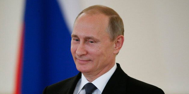 FILE - In this May 28, 2015 file-pool photo,Russian President Vladimir Putin attends a ceremony in the...