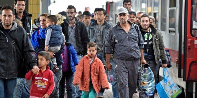 Refugees from Syria arrive at the train station in Dortmund, Germany, Sunday, Sept. 6, 2015. Thousands...
