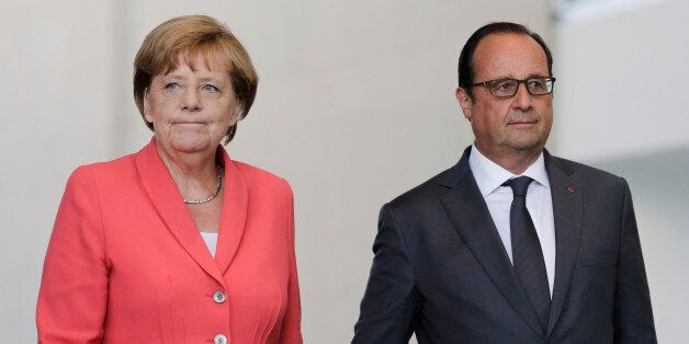German Chancellor Angela Merkel, right, and French President Francois Hollande arrive for a press statement...