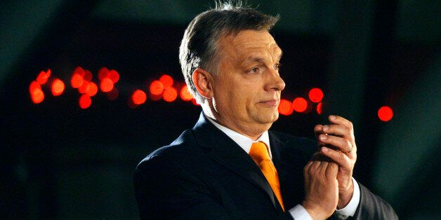 Hungarian Prime Minister Viktor Orban, leader of the ruling center-right Fidesz party applauds prior...