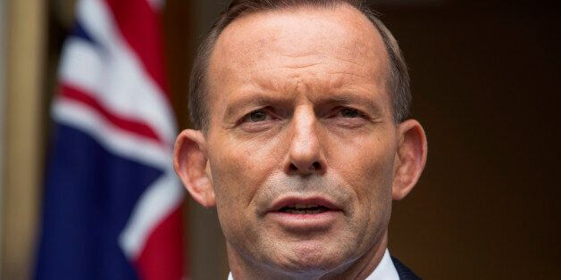 FILE - In this Feb. 9, 2015, file photo, Australian Prime Minister Tony Abbott answers questions at a...