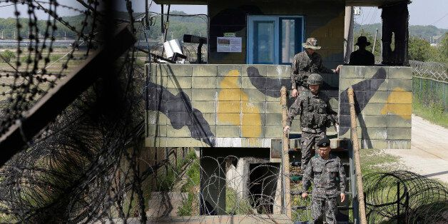 South Korean army soldiers step down from a military post guard near the demilitarized zone between the...