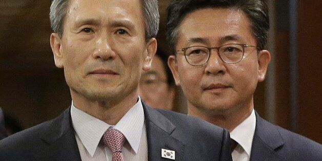 South Korean presidential security adviser Kim Kwan-jin, left, and Unification Minister Hong Yong-pyo...