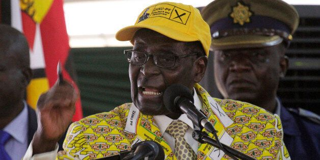 Zimbabwean President Robert Mugabe delivers his speech during the official opening of the Zanu pf 6th...