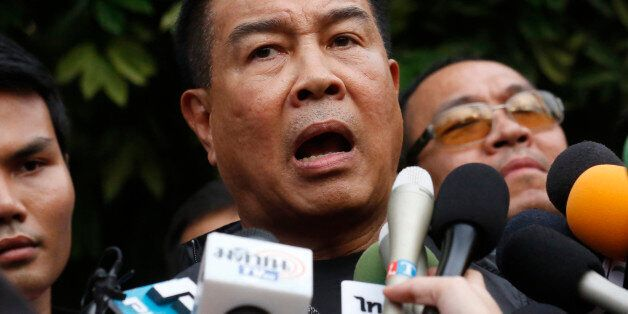Thai police chief Somyot Pumpunmuang talks to reporters outside of an apartment on the outskirts of Bangkok,...