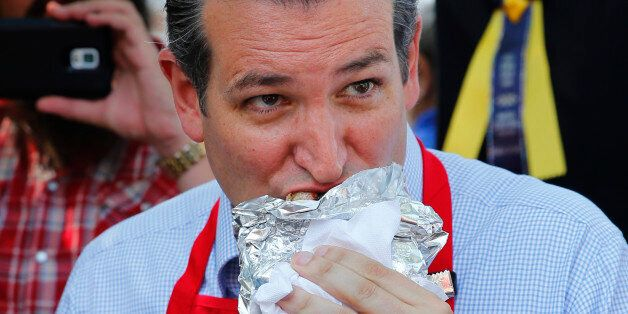 Republican presidential candidate, Sen. Ted Cruz, R-Texas, eats a pork chop at the Iowa State Fair, Friday,...