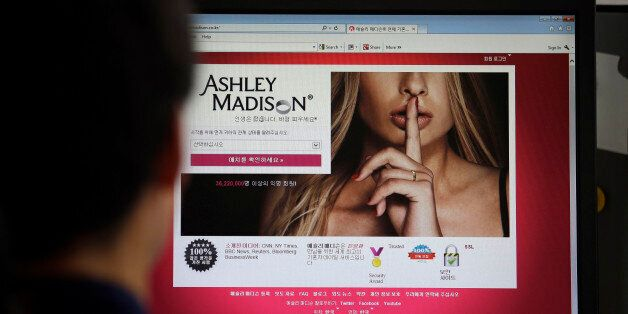 FILE - In this June 10, 2015 photo, Ashley Madison's Korean web site is shown on a computer screen in...