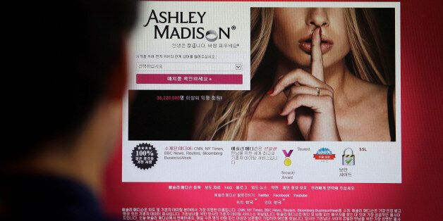 FILE - In this June 10, 2015 photo, Ashley Madison's Korean website is shown on a computer screen in...