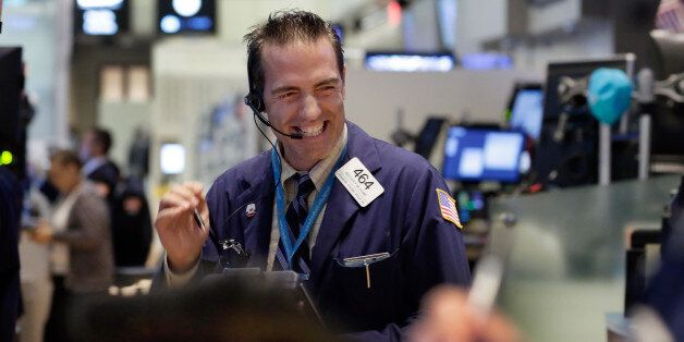 Trader Gregory Rowe works on the floor of the New York Stock Exchange, Wednesday, Aug. 26, 2015. U.S....