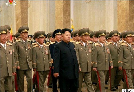 김정은, '준전시상태' 선포 : 군에 '완전무장'