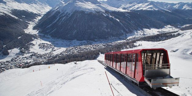 A cable train makes its way up the Weissfluhjoch mountain in Davos, Switzerland, Monday, Jan. 19, 2015....