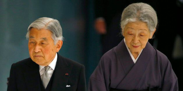 Japan's Emperor Akihito, accompanied by Empress Michiko, leaves after delivering his remarks during a...
