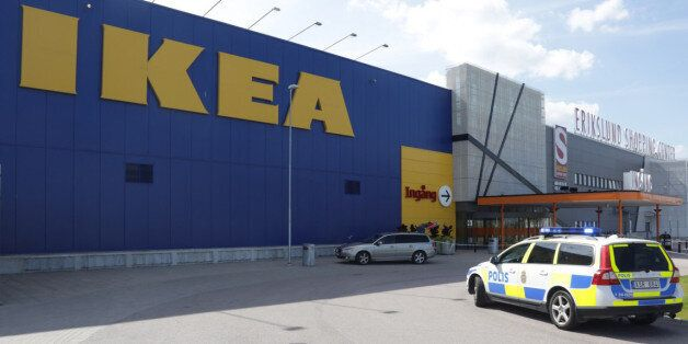 Police officers attend the Ikea store in Vasteras, Sweden, Monday Aug. 10, 2015, after three people were...