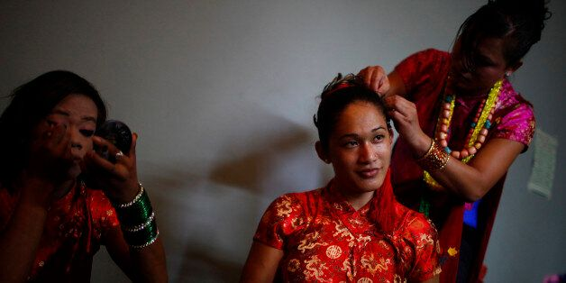 Participants prepare for a gay rally in Pokhara 200 kilometers (125 miles) from Katmandu, Nepal, Friday,...