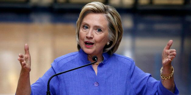 Democratic presidential candidate Hillary Rodham Clinton answers reporters questions about Republican...