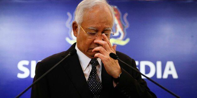 Malaysian Prime Minister Najib Razak, center, gestures before speaking at a special press conference...