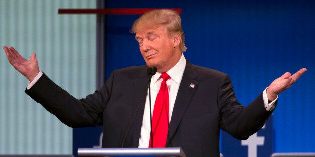 Republican presidential candidate Donald Trump gestures during the first Republican presidential debate...