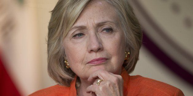 Democratic presidential candidate Hillary Rodham Clinton listens during a roundtable discussion on home...