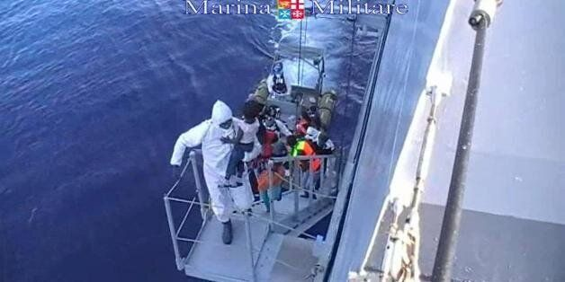 This image taken from video provided by the Italian Navy (Marina Militare) Saturday, Aug. 15, 2015, shows...