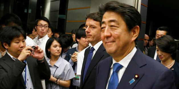 Italian Prime Minister Matteo Renzi, second from right, and his Japanese counterpart Shinzo Abe, right,...