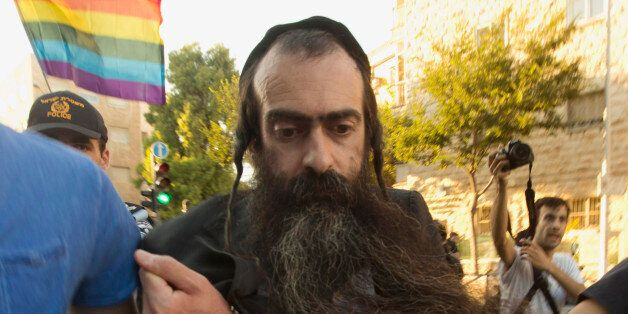 FILE - In this Thursday, July 30, 2015 file photo, ultra-Orthodox Jew Yishai Schlissel is detained by...