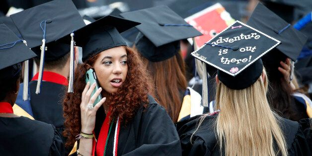 Graduates are seated during George Washington University's commencement exercises on the National Mall,...