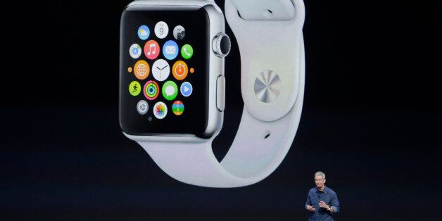 Apple CEO Tim Cook introduces Apple Watch on Tuesday, Sept. 9, 2014, in Cupertino, Calif. (AP Photo/Marcio...