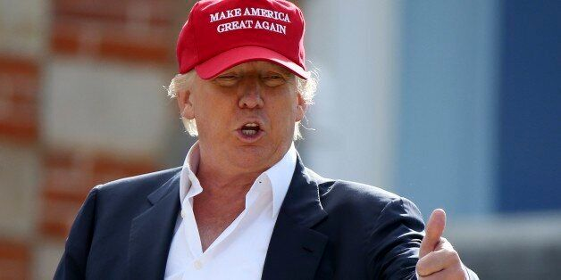 Presidential contender Donald Trump, speaks to the media after arriving by helicopter during the 1st...