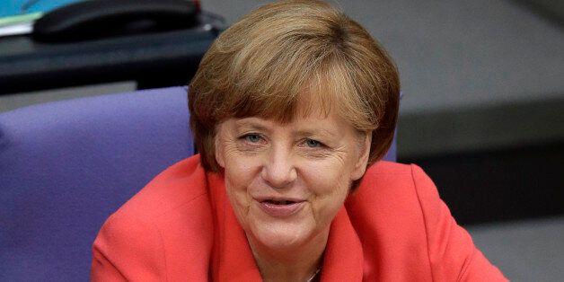 German Chancellor Angela Merkel smiles during a meeting of the German federal parliament, Bundestag,...