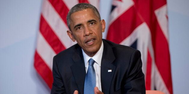 US President Barack Obama speaks to media as he and British Prime Minister David Cameron participate...