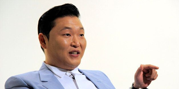 In this Wednesday, June 4, 2014 photo, South Korean musical performer Psy speaks during an interview...