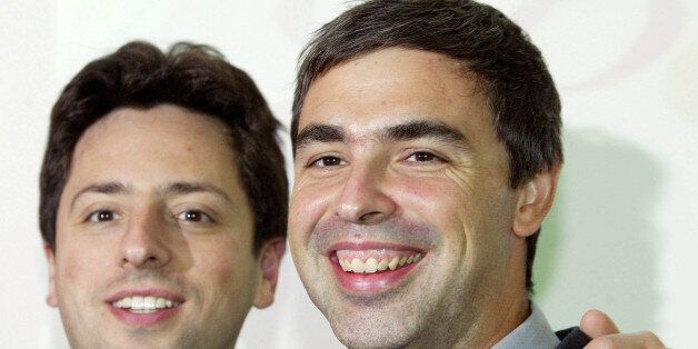 Google co-Founders Sergey Brin, left, and Larry Page are seen prior to a press conference at the International...