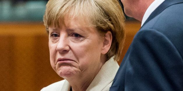 German Chancellor Angela Merkel, left, speaks with Romanian President Klaus Werner Iohannis during a...