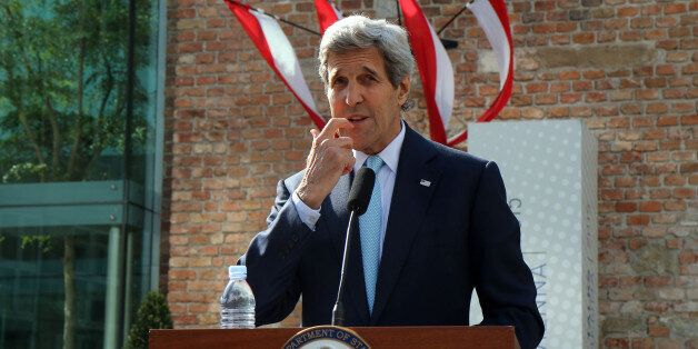 U.S. Secretary of State John Kerry informs the media in front of Palais Coburg where closed-door nuclear...