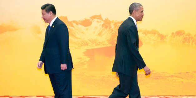 U.S. President Barack Obama walks past Chinese President Xi Jinping during a welcome ceremony for the...