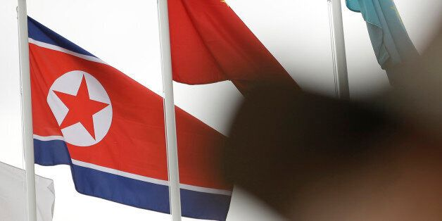 FILE - In this Tuesday, Aug. 26, 2014 file photo, a North Korean flag is hoisted during Media Day of...