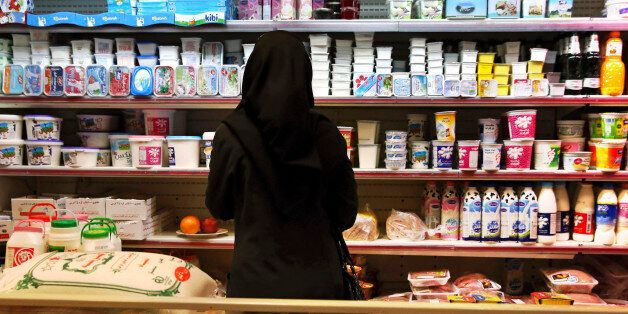 An Iranian woman looks at goods on the shelves in a supermarket in north Tehran, Iran, Wednesday, April...