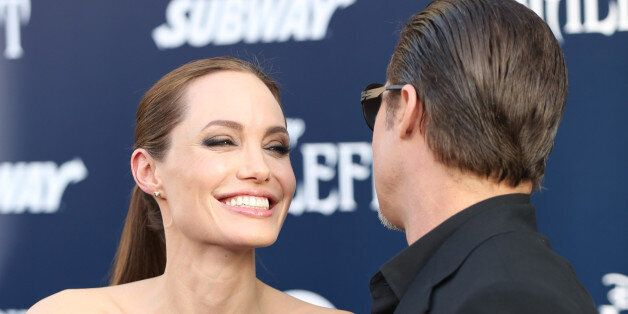 Angelina Jolie and Brad Pitt arrive at the world premiere