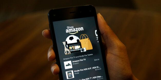 FILE - This June 18, 2014, file photo shows the app that links to shopping on Amazon.com on the new Amazon...
