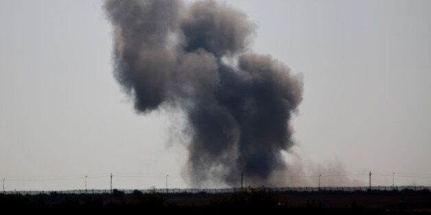 Smoke rises following an explosion in Egypt's northern Sinai Peninsula, as seen from the Israel-Egypt...