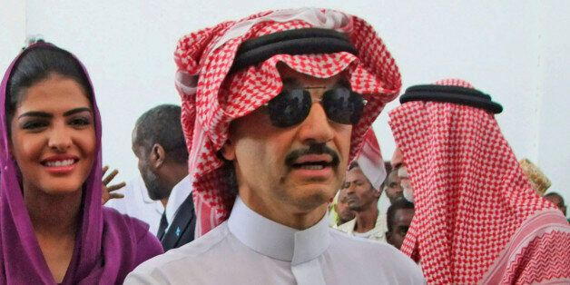 Prince Al-Waleed bin Talal Bin Abdulaziz Alsaud, Chairman of the Alwaleed Bin Talal Foundation, right,...