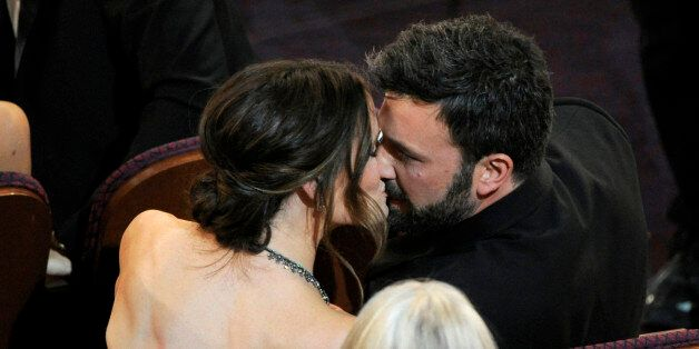 Jennifer Garner, left, kisses director Ben Affleck