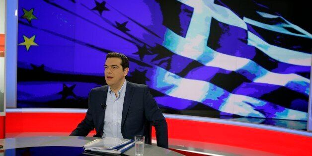 Greece's Prime Minister Alexis Tsipras prepares for a TV interview at the State Television (ERT) in Athens,...