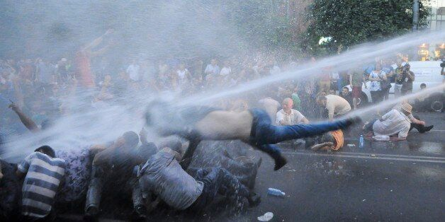 Armenian police use water canons to disperse protesters demonstrating an increase in electricity prices...