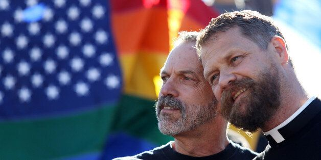 Michael Deschenes, left, and Cary Bass, who had church wedding and plan to become legally married, stand...