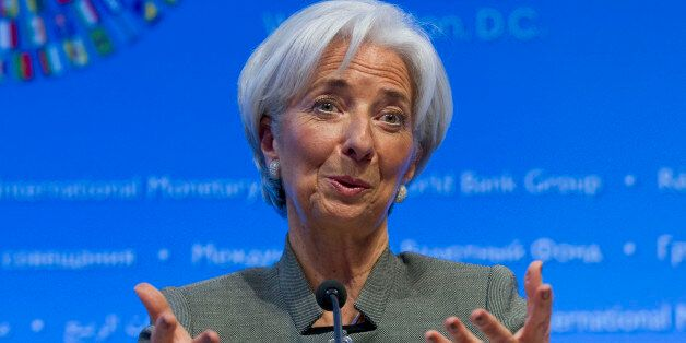International Monetary Fund (IMF) Managing Director Christine Lagarde gestures while speaking at a news...
