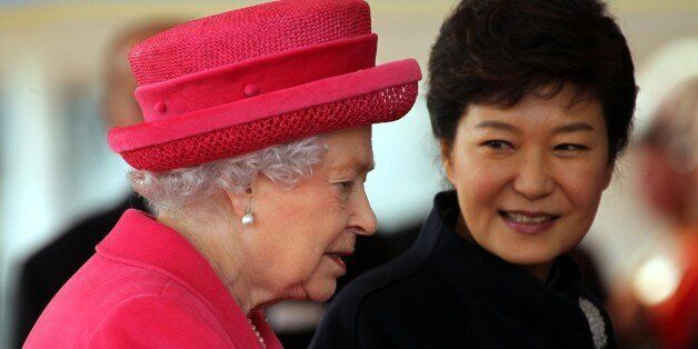 Britain's Queen Elizabeth II, left and South Korea's President Park Geun-Hye arrive at the Grand Entrance,...